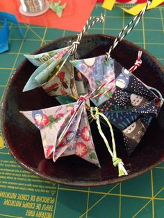 How to Make an Origami Ornament for Christmas Here are some finished ornaments made from Totoro washi paper (I love Totoros!) and threaded with colorful paper cord. The post How to Make an Origami Ornament for Christmas appeared first on Paper Ideas. Christmas Origami, Christmas Crafts, Christmas Decorations, Christmas Christmas, Origami Ornaments, Paper Ornaments, Origami Design, Fabric Origami, Origami Paper