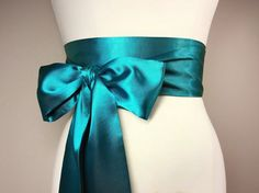 Light Teal Sash Deep Turquoise Satin Sash Teal Satin Sash Belt Obi Sash Belt Bridesmaid Sash Teal Wedding Accessories Satin Swank  This Satin Swank® reversible waist sash is the perfect finishing touch for your wedding, bridesmaid, or special occasion dress, or just the right piece to add instant polish to your dress or top. This sash is 3.5 inches wide, 120 inches long, and will wrap around most waist sizes two times with a generous length remaining to tie in a bow or a simple knot with…