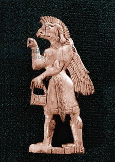 I An Assyrian-style ivory inlay in Fort Shalmaneser depicting a winged, eagle - headed genie holding a situla and cone Title: Werner Forman Archive Credit: High scan only Culture: Phoenician work Date/Period: Probably 8th century Place of Origin: Ancient Iraq Material Size: Ivory / Iraq Museum, Baghdad