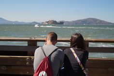 couple just passing time with view over alcatraz in san francisco. pretty amazing place to pass time according to me.