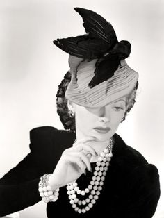 Lucille Ball Models a Unique Hat for a Publicity Still, 1940's