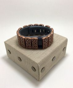 FabFit Bracelet Cover for Fitbit Charge Bronze Swirl Scroll Style by FabFitBracelets on Etsy https://www.etsy.com/listing/274266118/fabfit-bracelet-cover-for-fitbit-charge