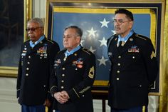 The 3 living recipients of Medal of Honor among 24 Army veterans whose gallantry had finally been fully recognized stand during ceremony at White House,March 18,2014.L to r,Sgt.1st Class Melvin Morris,Master Sgt.Jose Rodela & Sgt.Santiago J.Erevia.All 3 earned nation's highest award for battlefield gallantry during Vietnam War.The 24 soldiers from WWII,Korean War & Vietnam Waroriginally received Distinguished Service Cross,& congressionally directed review resulted in awards being upgraded.