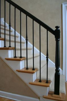 Photo: Painted Black Handrail and Newel Posts with Hammered Straights and Single Spoons
