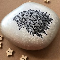 "20 Likes, 2 Comments - Jade Elliott (@sparklejadey) on Instagram: ""Game of Thrones rock for my Dad 🐺🎨#gameofthrones #rockpainting #acrylicpainting #handmade…"""