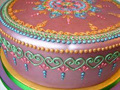 A purple Henna Mehndi cake decorated with a green, blue, gold and pink geometric… Henna Wedding Cake, Mehndi Cake, Henna Mehndi, Wedding Cakes, Mehndi Party, Mehendi, Cake Icing, Buttercream Cake, Eat Cake