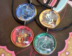 Harry Potter Hogwarts' Houses Necklaces. $26.40, via Etsy.