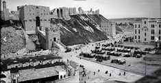 Photograph taken from the minaret of al Khosrofieh mosque looking northeast towards the entrance of Aleppo Citadel. Naher Osten, Aleppo, Baghdad, This Is Us Quotes, Damascus, Islamic Art, Mosque, Old Photos, Entrance