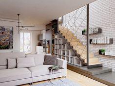 un escalier moderne en bois avec rangement bibliothèque
