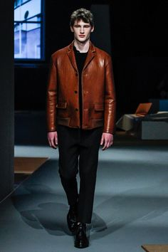 "FALL 2013 MENSWEAR  Prada /  While you reflect on Miuccia Prada's comment that she considered the presentation ""one of the most sophisticated I've ever done."" Surely she was having us on. As Miuccia went on to explain herself, her logic became clear. ""Simplicity is so difficult. To make perfect something that is normal and classic is much harder."" And make no mistake, Prada was in pursuit of perfection this season."