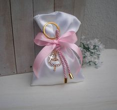 Elegant favor for the Orthodox baptism day White satin bag bomboniera decorated with a beautiful-ballerina-key chain. Each favor includes 3 sugared almonds (koufeta). Satin bags lenght about 5 Total key chains lenght including the key ring, about 4,72 Key rings diameter is 1.18 All