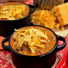 Cheesy Taco Soup Recipe Main Dishes, Soups with lean ground beef, butter, flour, milk, salt, shredded cheddar cheese, taco seasoning, rotelle, black beans, tortilla chips