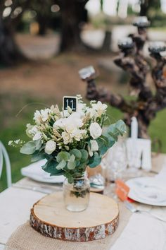Rustic Centrepiece | Hessian Table Runner | Wooden Tree Slab | Jar filled with Flowers | Destination Wedding At French Chateau | Photography by Phan Tien | http://www.rockmywedding.co.uk/marcella-sorene/