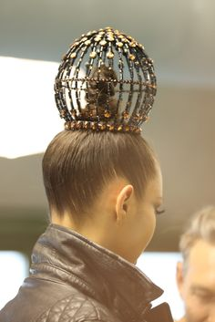 Crowning glory. Backstage at Jean Paul Gaultier Fall Couture 2013