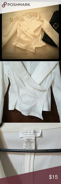 """Jackie Jon New York Blouse Jackie Jon Top. Perfect for a Christmas party. Can be paired with dark wash jeans or skirt. Great condition. ? Polyester ?Zipper on the back ?Wrap detail on front ?Cuffed sleeves ?Dry clean only  Measurements: Armpit to armpit:16"""" Length: 22"""" Arm length 22"""" Armpit to hemline 11"""" Jackie Jon New York Tops Blouses"""