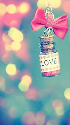 Love bows and glitter bottle wallpaper for phone and ipad
