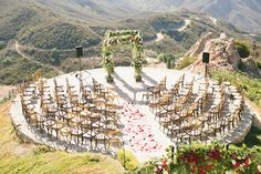 Overlooking the gorgeous Pacific coast, this Malibu wedding was blanketed in red roses! See the photos captured by Onelove Photography.