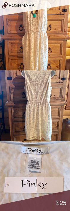 Pinky Ivory Lace Dress Beautiful ivory lace dress. Elastic waist. 2 pockets. Fully lined. Selling for my daughter. Pinky Dresses Midi