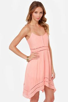 Volcom Last Call Peach Tank Dress: Did someone order another round of adorable, because this dress is undeniably so. Crinkly peach woven material forms a wide-cut bodice with rows of open embroidery around the waist. Matching embroidery trims a full skirt with a square-cut hem that hangs longer at the sides. Adjustable spaghetti straps. Embroidered logo at back. Dress is lined. 100% Viscose. Hand wash cold $55