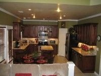 Traditional Kitchen with Brandywine Kitchen Cabinets.  They chose a warm, olive color to compliment the cabinets.