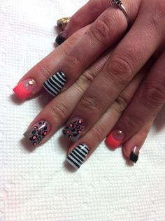 Bright and stripes with cheetah make for a beautiful combo on acrylic nails