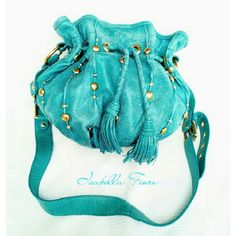 ISABELLA FIORE  BLUE - TEAL HANDBAG NWOT ISABELLA FIORE BLUE-TEAL GATHERED HANDBAG (*As seen on Ebay- $799.00 please see pictures) Exterior  *. GreenBlue-Teal w/Isabella FIORE Signature                   * Leather Handles w/Brass Studs                   * Crackled Appearance                    * Measurements (approx) H11 X L13 X W6 Interior.   *1 Zip Pockets & 3 Slip Pkts                   * 3 Stove Components                   * Green Daisy Pattern ABSOLUTELY BEAUTIFUL!    Add'l pics if…