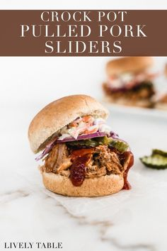 Easy slow cooker BBQ pulled pork sliders with homemade healthier coleslaw are sure to be a hit at your next spring tailgate or party! Cooking and cleanup are a breeze thanks to the slow cooker, so you can enjoy the game and your company. (Includes Instant Pot instructions)