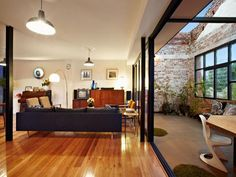 Eclectic Home Interior from Converted Warehouse: Nice Connection Of Indoor Main Living Room With Outdoor Terrace Of Abbotsford Warehouse Con. Warehouse Apartment, Warehouse Living, Warehouse Home, Warehouse Renovation, Converted Warehouse, Warehouse Conversion, Modern Interior Design, Interior Architecture, Melbourne Architecture