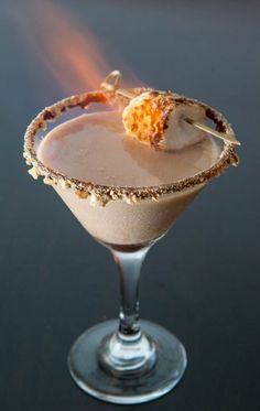 Flaming s'mores martini!  So beautiful and perfect for chilly dark nights!  @Rock My Wedding #rockmywinterwedding. Find accommodation using www.hotelsavailable.co.uk & book direct with the hotel.