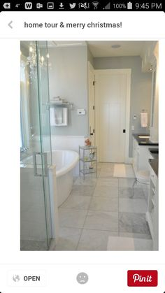 The white tile on the wall and grey tile on the floor are very serene and clean looking.