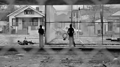 Kids playing under a parking lot in New Orleans, Louisiana