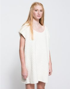 From Margaux Lonnberg, an oversized knit dress in heather White with minimalist styling. Features allover circle texture, scoop neckline, capped sleeves, on seam side pockets, flare cut, rounded hem, fully lined and relaxed fit.  •	Oversized knit dress