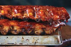 Our ultimate barbecue-smoked ribs are finished with a delectable molasses barbecue sauce. Serving six to eight, this recipe is perfect for your next outdoor gathering. Photo by Jeff Coulson. Barbecue Recipes, Grilling Recipes, Cooking Recipes, Barbecue Sauce, Campfire Recipes, Smoker Recipes, Canadian Living Recipes, Canadian Food, Canadian Cuisine