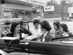 Teenage Girls Enjoying Milkshakes at Drive In Restaurant, 1957