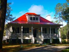 HGTV 1998 Dream Home - Red metal roof, large front porch. I would like the roof to be gray or brown. Cottage House Plans, Craftsman House Plans, Modern House Plans, Farm Cottage, Farm House, Low Country Homes, Red Roof House, Hgtv Dream Homes, Porch House Plans