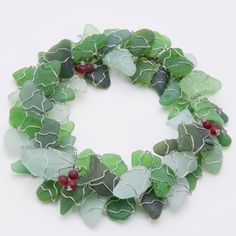 "Sea glass wreath. Strangely appealing. Looks better than normal overtly ""beachy"" themed xmas decor."