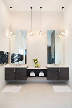 Contemporary Master Bathroom with limestone tile floors, frameless showerdoor, Quartz countertops, Shower, Pendant light