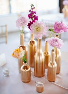 10 Unbelievably Creative Centerpiece Ideas: Mono-Floral Arrangements. Alternate the size or color of the flowers and vases for an eclectic mix-and-match look. Photo by Sara & Rocky Photography