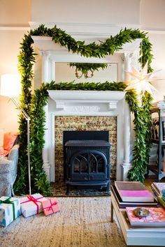 Pin for Later: 15 Awe-Inspiring Holiday Mantels  What's better than one garland? Two! Double up to create a rich, sweeping look atop your mantel that draws the eye upward.