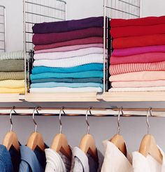 Use shelf dividers to separate stacks of shirts and sweaters.