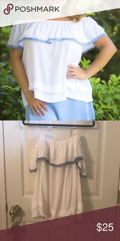 White off the shoulder top Fantastic white off the shoulder top with blue accent. NWT. 100% rayon Tops