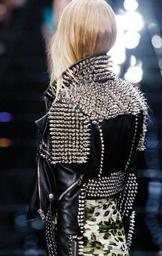 This unique looks appears to be srwing inspiration from the 60s from both the rockers by using a heavy black jacket and the punks with the extreme studs.
