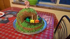 I made a train cake with tunnel. Tunnel made from a Bundt cake on its side. Vanilla Oreo crumbles and shredded coconut with green food coloring for grass held on with chocolate frosting. Chocolate Oreo crumbles for ballast under the train. Chocolate Oreo, Chocolate Frosting, Mini Mouse Cupcakes, Birthday Cakes, Birthday Parties, Train Party, Green Food Coloring, Shredded Coconut, Grass