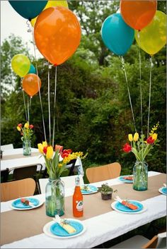 Anchor balloons to buckets of crayons (weighted buckets- sand or rock) and have the table runner be something to color or draw. If not, have place mats to color.