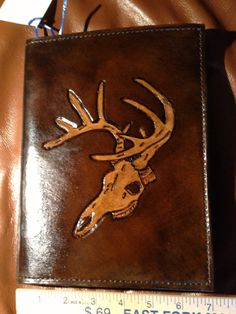 A personal favorite from my Etsy shop https://www.etsy.com/listing/264377884/stag-head-leather-notepad-attache