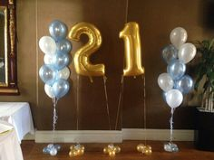 Large number balloons in 21, the gold looks lovely next to the soft blue and white balloons. S.