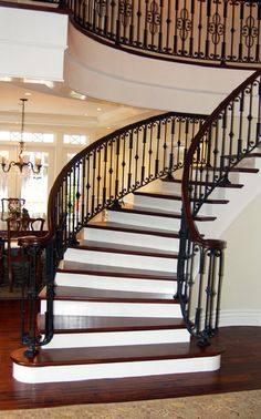 Love this grand staircase. Especially the iron work!
