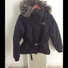 Coat with faux fur hood Down feather north face winter coat in black. Belted with Faux fur hood. Only worn a small amount of time. Got pregnant and too bug shortly after buying it. In great condition. The North Face Jackets & Coats Puffers