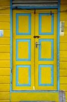 Bright blue and yellow entryway in Brunei.  Doors of the world.  travel.  Asia.  doors.