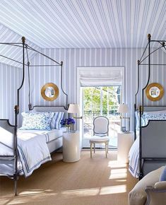 Sophisticated guest room, with great metal bed frames! Tranquil color scheme!